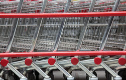 Stacked Shopping Carts. With red details Royalty Free Stock Photos
