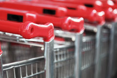 Stacked shopping sarts. Stacked shopping carts with red handles Royalty Free Stock Photography