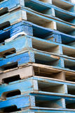 Stacked skids. Blue wooden stacked skids which fill the entire frame Stock Image