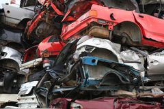 Cars for scrap. Stacked smashed cars for scrap, colorful, old and new royalty free stock photos