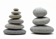 Stacked spa stones. Two stacked spa zen stones / rocks on white background Royalty Free Stock Photo