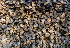 Stacked splitted firewood background royalty free stock photo