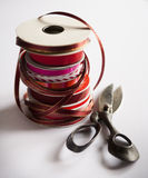 Stacked spools of holiday ribbon Stock Image