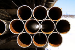 Stacked steel pipes. Looking threw a pile of steel pipes stacked Stock Photo