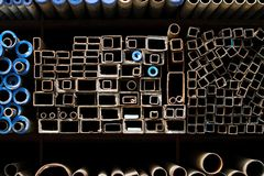 Stacked steel pipes and tubes Stock Image
