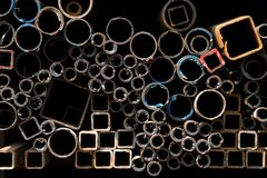 Stacked steel pipes and tubes Royalty Free Stock Images