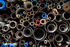 Stacked steel pipes and tubes Stock Photos