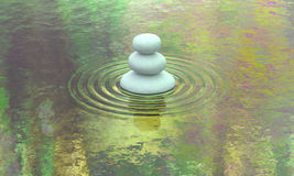 Stacked stone lake calm water view. Rocks stacking up order by size placed on peaceful pond with reflective water like one of Monet famous painting. Meaning of Royalty Free Stock Photo