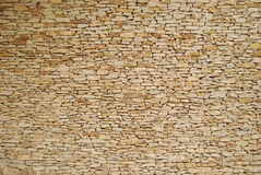 Stacked stone wall. A stacked stone wall in light colors Stock Image