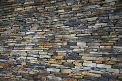 Stacked stone wall. Beautiful traditional stacked stone wall royalty free stock photo