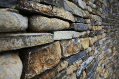 Stacked stone wall. Weathered old stacked stone stock photos
