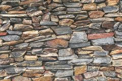 Stacked stone wall background. Stock Photo