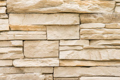 Stacked stone wall background, texture detail Royalty Free Stock Images