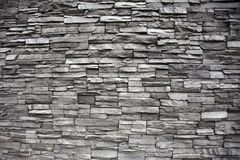 Stacked stone wall with different heights stock image