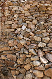 Stacked stone wall of several sizes. 1 Royalty Free Stock Image