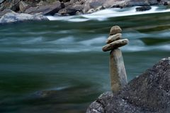 Stacked Stones. Stones stacked on a rock Stock Image