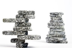 Stacked stones. Two stacks of stones balanced and isolated on white Royalty Free Stock Photography