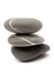 Stacked Stones. Three gray stones stacked on each other. Isolated on a white background Royalty Free Stock Photography