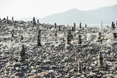 Stacked stones on a background of beach and sea Royalty Free Stock Image