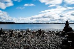 Zen stones on lakeshore Royalty Free Stock Image