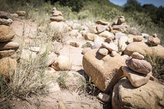 Stacked stones in the countryside Stock Images