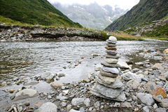 Stacked stones that indicate the direction Stock Photography