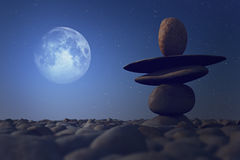 Stacked stones in moonlight Stock Images