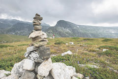 Stacked stones in the mountain Stock Images