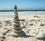 Stacked stones by the Ocean. Royalty Free Stock Photo
