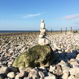 Stacked stones on beach in Wales UK Royalty Free Stock Photos