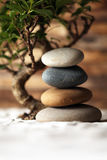 Stacked stones on sand stock photo