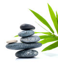 The stacked of Stones spa treatment scene and bamboo leaves . Stock Images