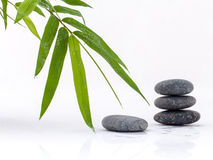 The stacked of Stones spa treatment scene and bamboo leaves with Stock Image