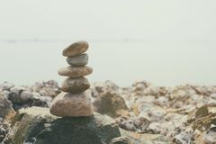 Stacked of stones on the summer coast in calmness and relaxation. Concept for design in your work Stock Photo