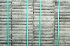 Stacked stones. Stacked tiles are waiting to be constructed for the pavement of a sidewalk. These are new tiles royalty free stock photography