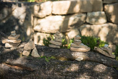 Stacked stones on a tree. In a temple royalty free stock photo