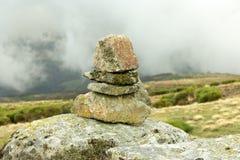 Stacked stones on trekking mountain trail stock photos