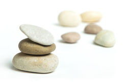 Stacked stones white isolated Stock Photos