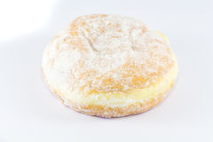 Stacked sugared donuts. Over white background stock photography