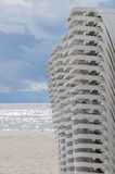 Stacked sun loungers on the beach before storm. Travel background stock photography