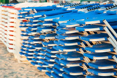 Stacked sunbeds. On the beach ready for clients royalty free stock image
