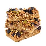 Stacked superfood breakfast bars with oats and blueberries isolated on white. Stack of superfood breakfast bars isolated on a white background Royalty Free Stock Image