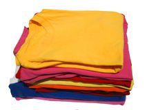 Stacked T-shirts. Colorful pile of laundered T-shirts royalty free stock photos