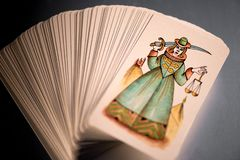 Stacked tarot cards showing Justice uppermost Royalty Free Stock Photography