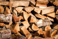 Stacked timber resources. Raw timber material stacked up and ready to be used Royalty Free Stock Image