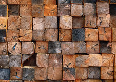 Stacked timber. Wooden log texture wall. Stock Image