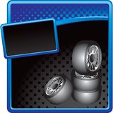 Stacked tires on blue and black halftone ad Royalty Free Stock Photos