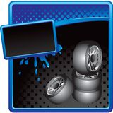 Stacked tires on halftone grungy advertisement Royalty Free Stock Image