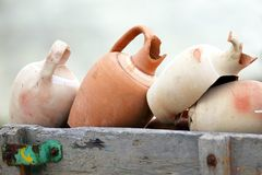 Stacked together broken clay pots. The stacked together broken clay pots Stock Photo