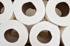 Stacked toilet paper. Stacked toilet white paper rolls royalty free stock photos